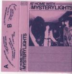 Raritní vydání magnetofonové kazety The Mystery Lights: At Home With The Mystery Lights (2015, Hologram Skies Records) s nákladem pouhých 150 kusů