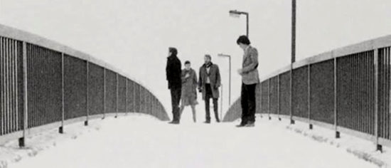 Joy Division, by Kevin Cummins, on the Princess Parkway, Hulme, Manchester, 6 January 1979